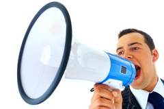 Photo of a man speaking into a megaphone to demonstrate that soundproofing is required when there are noise problems.